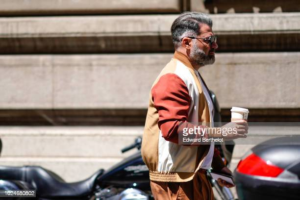 A guest wears sunglasses a brown bomber jacket outside Thom Browne during Paris Fashion Week Menswear SpringSummer 2019 on June 23 2018 in Paris...