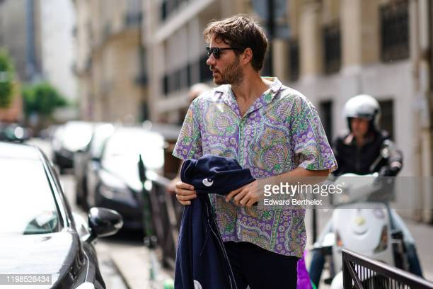 Guest wears sunglasses, a colorful oriental print shirt, outside Bode, during Paris Fashion Week - Menswear Spring/Summer 2020, on June 18, 2019 in...