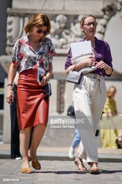 A guest wears sunglasses a flower print shirt a red leather skirt brown shoes outside the Chanel show during Paris Fashion Week Haute Couture...
