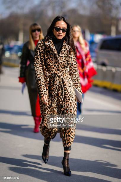 A guest wears sunglasses a leo print jacket during Paris Fashion Week Womenswear Fall/Winter 2018/2019 on February 28 2018 in Paris France