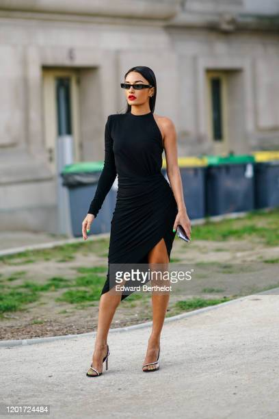 Guest wears sunglasses, a one-shoulder dress, high heel shoes, outside Alexandre Vauthier, during Paris Fashion Week - Haute Couture Spring/Summer...