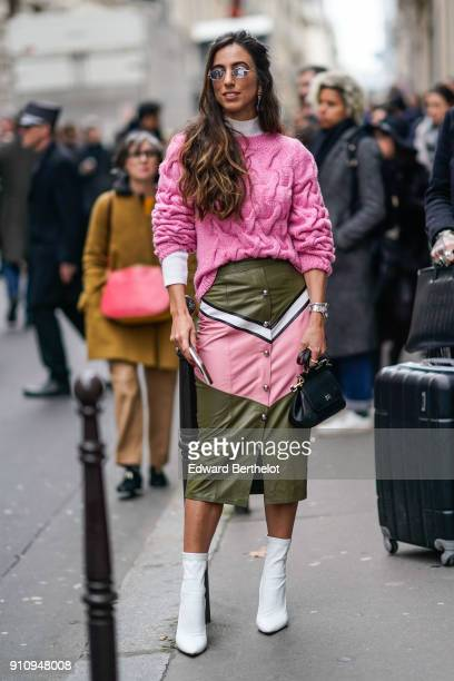 A guest wears sunglasses a pink pull over a green and pink skirt white shoes a bag outside Elie Saab during Paris Fashion Week Haute Couture...