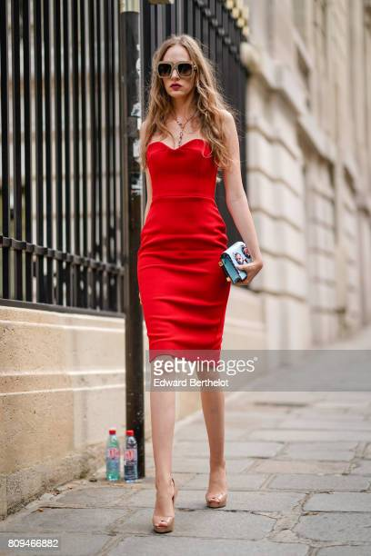 A guest wears sunglasses a red dress outside the Zuhair Murad show during Paris Fashion Week Haute Couture Fall/Winter 20172018 on July 5 2017 in...