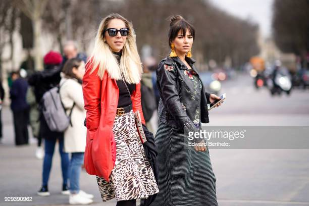 A guest wears sunglasses a red leather jacket a leopard print skirt outside Chanel during Paris Fashion Week Womenswear Fall/Winter 2018/2019 on...