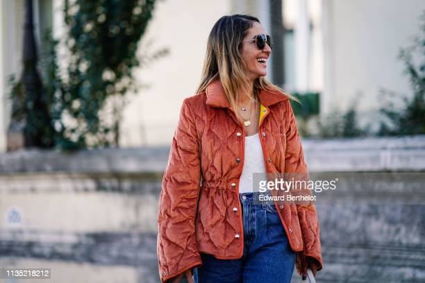A guest wears sunglasses a rustcolor corduroy jacket a white top jeans outside Dries Van Noten during Paris Fashion Week Womenswear Fall/Winter...