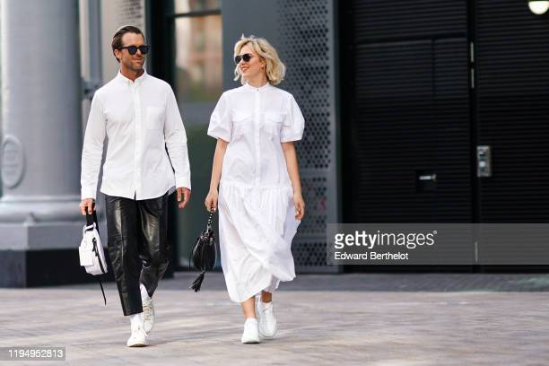 A guest wears sunglasses a white shirt a white fanny pack bag black leather cropped pants white sneakers a guest wears sunglasses a white dress white...