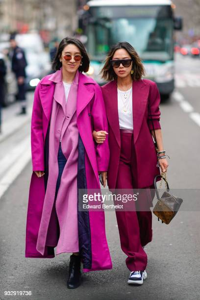 A guest wears sunglasses a white top a pink maxi trench coat a fuchsia coat blue jeans black booties a guest wears sunglasses a white top a raspberry...