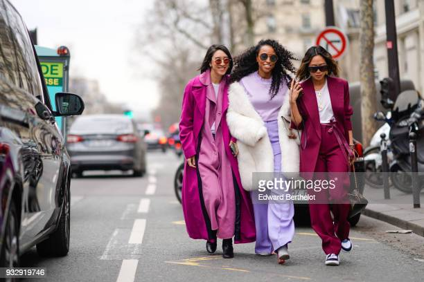 A guest wears sunglasses a white top a pink maxi trenchcoat a fuchsia maxi coat fuchsia socks black shoes a guest wears sunglasses a white faux fur...