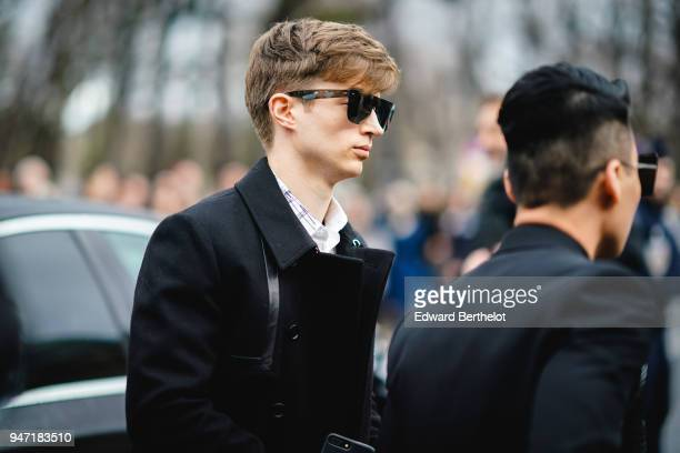 A guest wears sunglasses and a black jacket outside Dior during Paris Fashion Week Menswear Fall Winter 20182019 on January 20 2018 in Paris France