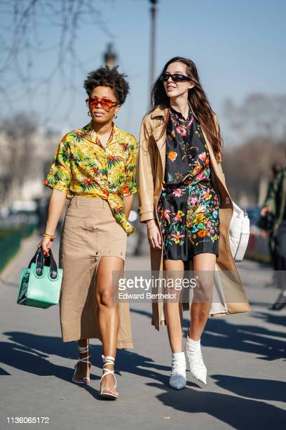 A guest wears sunglasses earrings a Hawaiian shirt a beige frontsplit skirt with eyelets a green bag white gladiator sandals Estelle Chemouny wears...