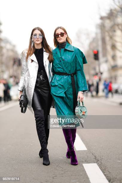 A guest wears sunglasses one large earring a black top a glossy silver coat black leather skinny pants a black studded handbag black suede overknee...