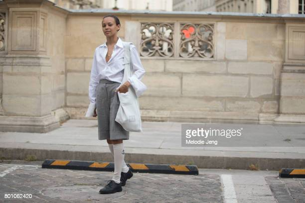 A guest wears Thom Browne outside the Thom Browne show on June 25 2017 in Paris France