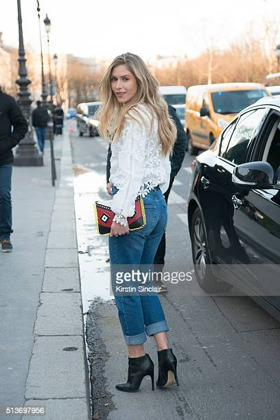 Guest wears Urban Outfitters jeans SelfPortrait top and Les Petits Joueurs bag on day 3 during Paris Fashion Week Autumn/Winter 2016/17 on March 3...