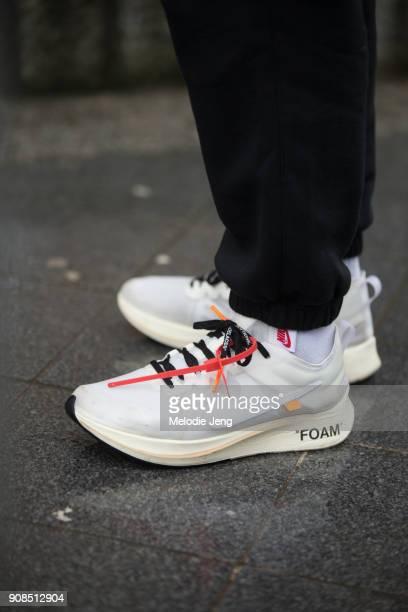 A guest wears Virgil Abloh x Nike Ten Nike Icons FOAM sneakers on January 21 2018 in Paris France