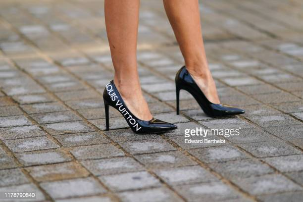 A guest wears Vuitton pointy shoes outside Louis Vuitton during Paris Fashion Week Womenswear Spring Summer 2020 on October 01 2019 in Paris France