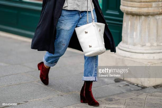 A guest wears white bag and red velvet shoes outside Anrealage during Paris Fashion Week Womenswear Spring/Summer 2018 on September 26 2017 in Paris...