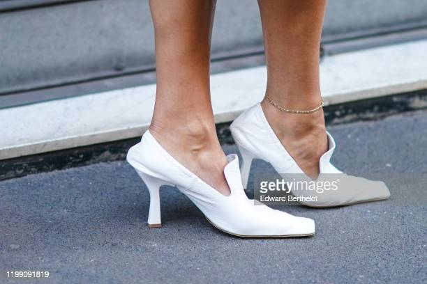A guest wears white shoes outside Etro during Milan Fashion Week Menswear Fall/Winter 2020/2021 on January 12 2020 in Milan Italy