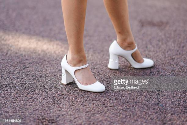 Guest wears white shoes, outside Miu Miu Club 2020, on June 29, 2019 in Paris, France.