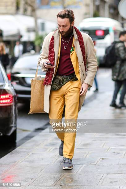 A guest wears yellow pants outside the JOUR/NE show during Paris Fashion Week Womenswear Fall/Winter 2017/2018 on February 28 2017 in Paris France
