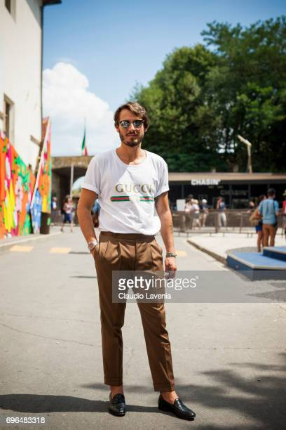 Guest weating Gucci tshirt is seen during Pitti Immagine Uomo 92 at Fortezza Da Basso on June 15 2017 in Florence Italy