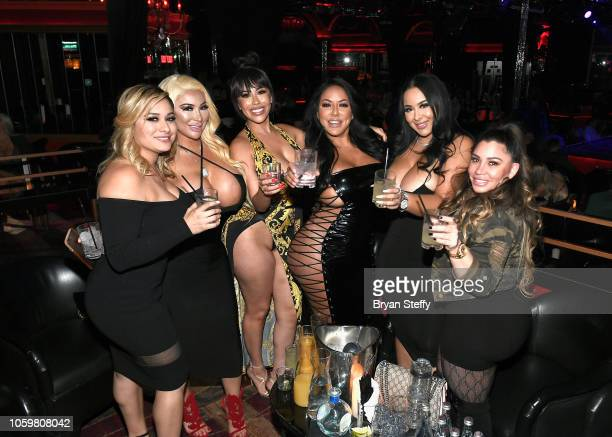Guest, webcam models MS Palomares, BBBLove, adult film actress Kiara Mia, webcam model Kassandra Cakes and a guest attend a late-night party at the...