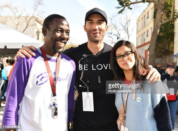 Guest Willie Justin Baldoni Gina Rodriguez pose for portrait at the Skid Row Carnival of Love on January 26 2019 in Los Angeles California