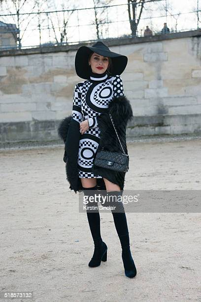 Guest with a Chanel bag on day 5 during Paris Fashion Week Autumn/Winter 2016/17 on March 5 2016 in Paris France Guest