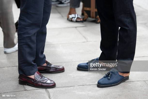 A guest with Ballet dancer Eric Underwood wears Kilgor trousers and Christian Louboutin shoes during London Fashion Week Men's on June 10 2018 in...