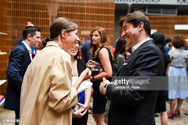 Guest with Bally Group CEO Frederic de Narp at the Bally Men's Spring Summer 2016 Presentation in Milan 21st June 2015