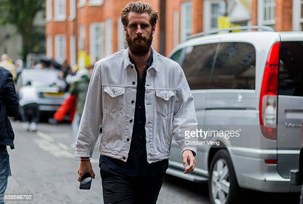 Guest with beard wearing a white denim jacket outside J.W. Anderson during The London Collections Men SS17 on June 12, 2016 in London, England.