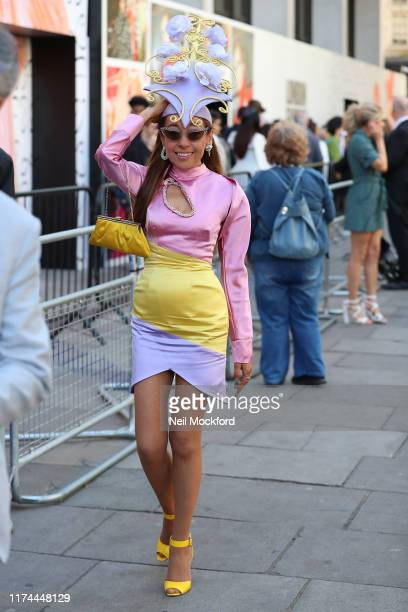 Guest with elaborate hat design arrives at BFC show space during London Fashion Week September 2019 on September 13 2019 in London England