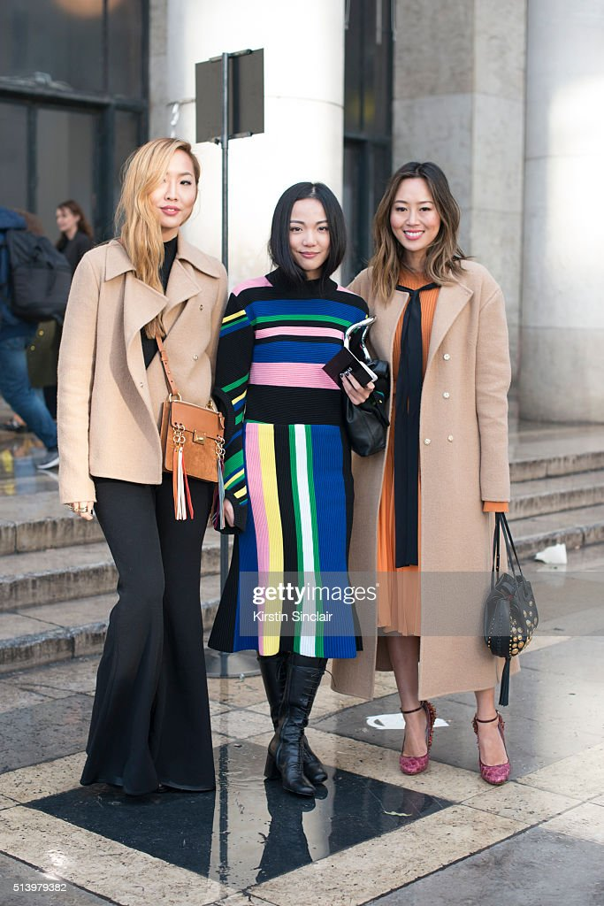 A guest with fashion blogger Aimee Song who wears a Chloe bag and