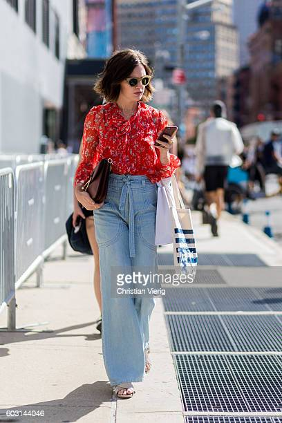 A guest with high waisted wide leg denim jeans outside J Crew on September 11 2016 in New York City