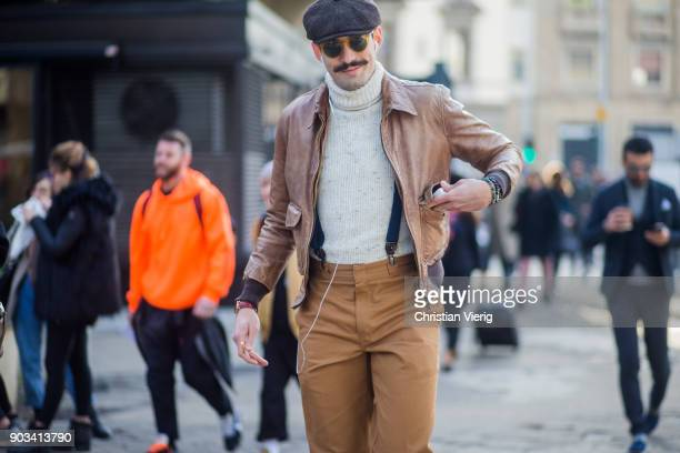 A guest with mustache wearing flat cap brown pants and leather jacket is seen during the 93 Pitti Immagine Uomo at Fortezza Da Basso on January 10...