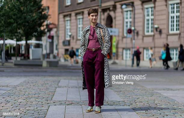 A guest with short hair wearing a leopard print coat and Gucci belt outside Nicholas Nybro during the first day of the Copenhagen Fashion Week...