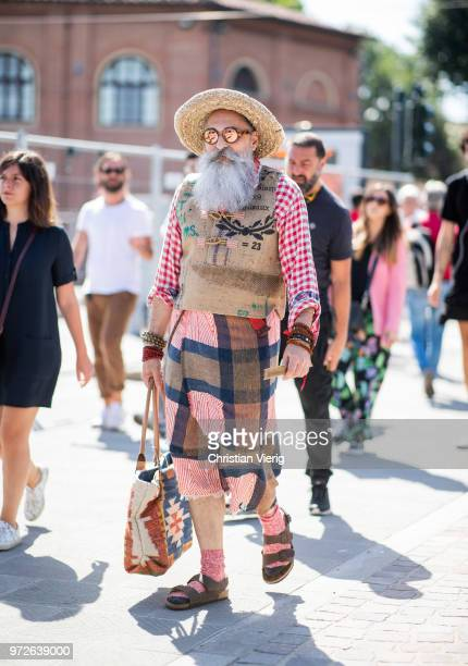 A guest with white beard wearing vest hat is seen during the 94th Pitti Immagine Uomo on June 12 2018 in Florence Italy