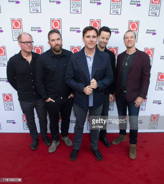 R Guest Zach Lind Jim Adkins Tom Linton and Rick Burch from Jimmy Eat World attend the Q Awards 2019 at The Roundhouse on October 16 2019 in London...