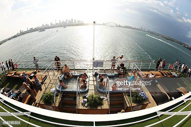 Guests aboard the Pacific Pearl relax leaving Sydney Harbour bound for Melbourne on November 1 2014 in Sydney Australia In the biggest single...