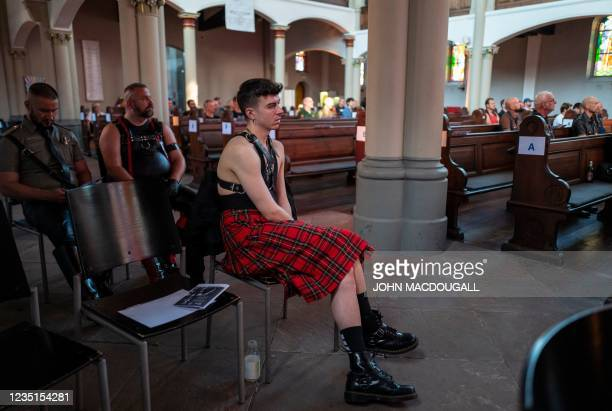 """Guests, almost fully clothed in leather, listen to a performance at the """"Classic meets Fetish"""" concert at the Twelve Apostles Church in Berlin on..."""