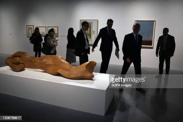 """Guests and authorities walking past a sculpture during the exhibition. """"De Miró a Barceló. Un siglo de arte español"""" exhibition at Centre Pompidou..."""