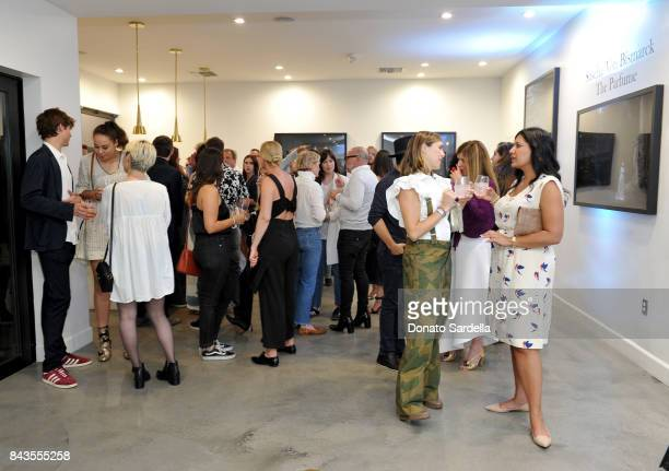Guests and celebrity floral and fragrance designer Eric Buterbaugh attend the private opening of Sascha von Bismarck debut photography collection...