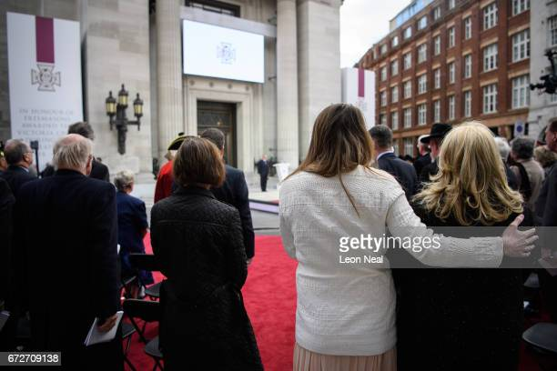 Guests and dignitaries listen to readings ahead of the unveiling of a monument outside the Freemasons' Hall listing the 64 servicemen who were...