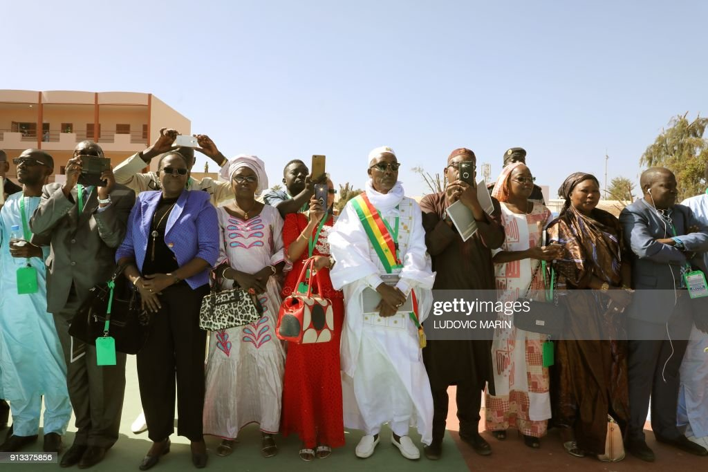 Guests and officials capture images as they greet the french and guests and officials capture images as they greet the french and senegalese presidents during the inauguration of the bel air secondary school in dakar on m4hsunfo