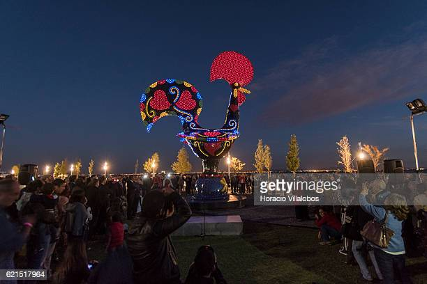 Guests and public observe as Led lights are switched on during the inauguration of Pop Galo, Portuguese artist Joana Vasconcelos public art work...