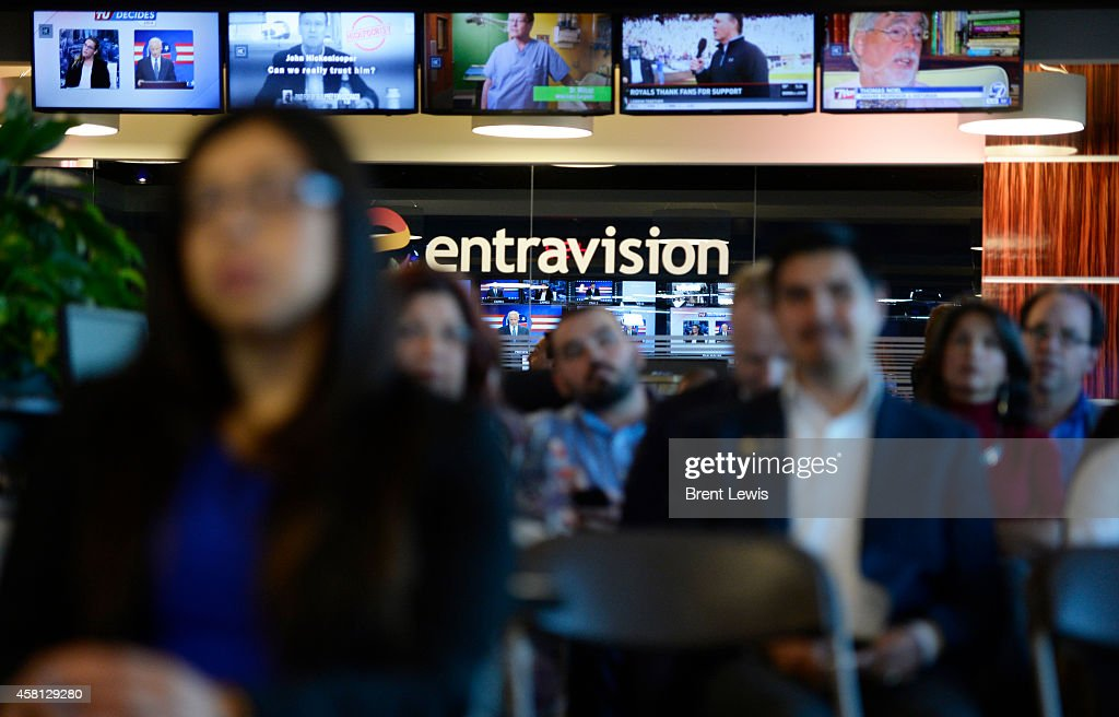 Guests and staff members of Entravision watch the live spanish