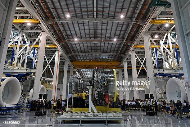 Guests and staffs of the Rolls Royce facility in Singapore gather during the unveiling ceremony of a RollsRoyce Trent 1000 aero engine Made in...