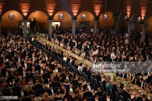 Guests and Swedish royal family attend a royal banquet to honour the laureates of the Nobel Prize 2019 following the Award ceremony on December 10,...