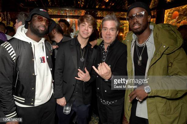 Guests Andy Hilfiger and Dadju attend the TOMMYNOW after party at Annabels on February 16 2020 in London England