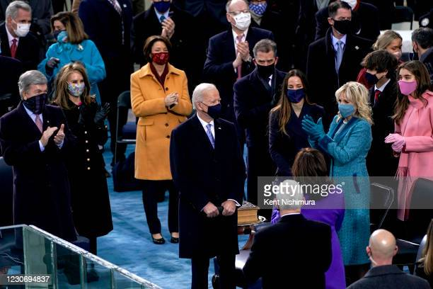 Guests applaud U.S. President Joe Biden after he was sworn in as the 46th President of the United State during the 59th presidential inauguration in...