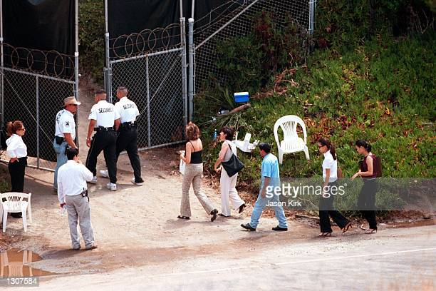 Guests are escorted July 29 2000 by security into the wedding of Brad Pitt and Jennifer Aniston in Malibu CA